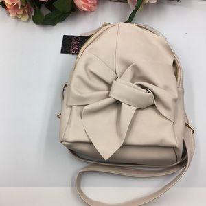 ddef7bd609fb Bags - NWT Pearl Handle Bow Mini Backpack Bag